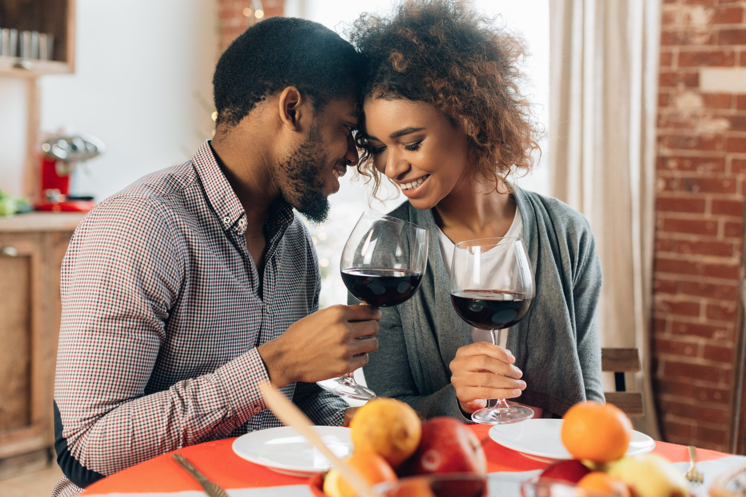 A couple enjoying a dinner date at home
