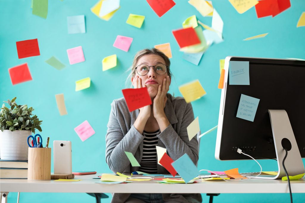 Business woman surrounded by Post-it notes