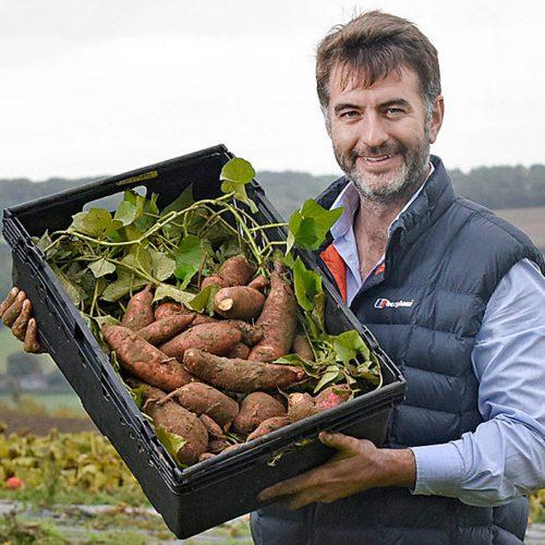Joe Cottingham from Watts Farm showing a box of freshly dug up sweet potatoes